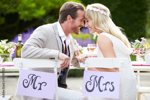 Leinwanddruck Bild Bride And Groom Enjoying Meal At Wedding Reception