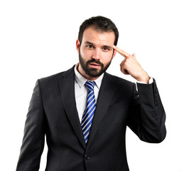 Businessman making a crazy gesture over white background