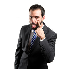 Young businessman making a mockery over white background