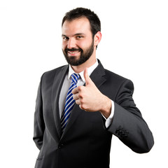 Young businessman getting OK over white background