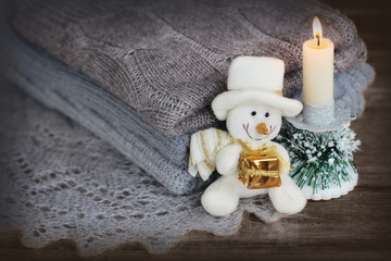 Christmas background with snowman and candle