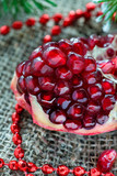 Fresh pomegranate with festive decorations