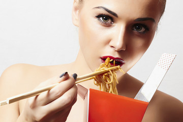 Beautiful woman are eating noodles.red lips.food delivery