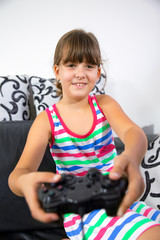 Portrait of a young girl playing video game