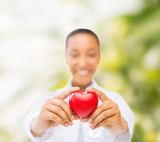 woman hands with red heart