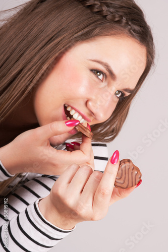 Cheerful woman enjoying cookies