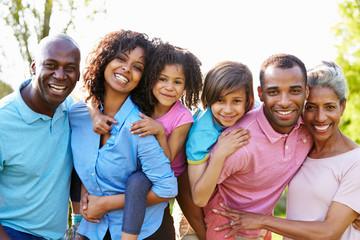 Multi Generation African American Family Standing In Garden