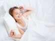 smiling girl child waking up in bed at home