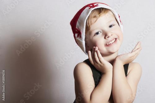 happy little boy in Santa hat. Christmas. smile
