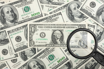 Look through a magnifying glass on the money