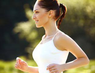 Athletic Runner Training in a park for Marathon.