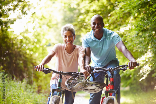 Mature African American Couple On Cycle Ride In Countryside - 58897104
