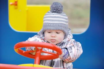 baby driving car on playground