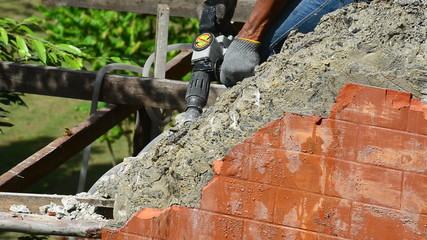 Jackhammer Breaks Concrete Wall