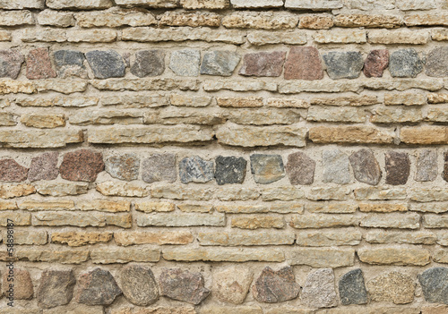 Background of old vintage limestone wall with granite stones