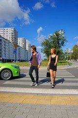 Girl and Boy walking on the pedestrian crossing