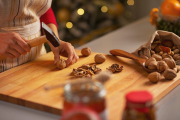 Closeup on housewife chopping walnuts