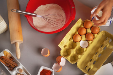 Closeup on table with flavoring eggs dough whisk rolling pin