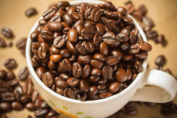 roasted coffee seed coffee cup background