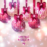 Christmas sale - Purple Christmas baubles on light background.