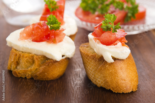 Bruschetta with mozarella and tomatoes
