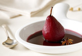 Closeup of a pear poached in red wine.