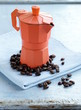 Still life of coffee beans and coffee pot