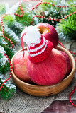 Red apples with hat in bowl, festive decorations
