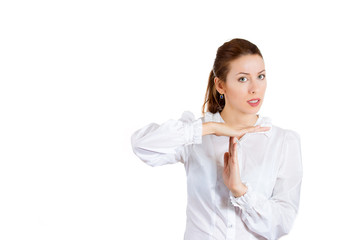 Serious woman showing time out sign gesture