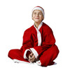The smiling Boy in a Santa Claus outfit posing on a white backgr