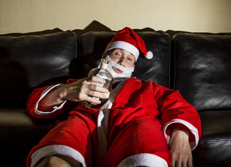 drunk Santa Claus posing with a bottle of whisky