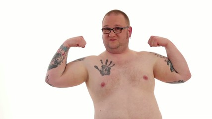 tattooed man muscle training and exercising
