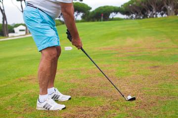 Close-up of a man playing golf