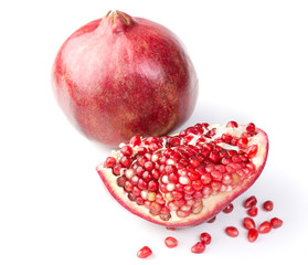 Fresh, ripe, organic pomegranate fruit on white background.