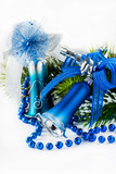 Blue Christmas bells on light background