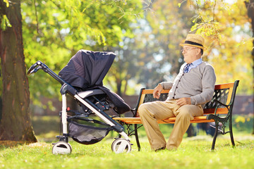 Grandfather sitting on a bench and looking at his nephew