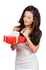 Fashion isolated woman portrait hold christmas gift.