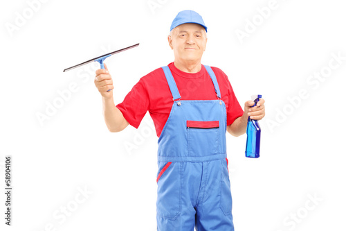 Male cleaner in uniform holding a cleaning equipment for glass