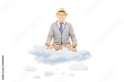 Senior gentleman with hat sitting on clouds and meditating