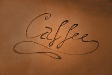 Schrift an der Fassade eines Cafes