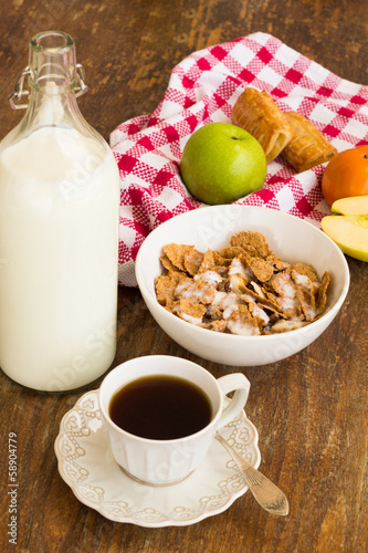 Healthy breakfast with granola, fruits, nuts and milk.