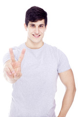 Handsome man giving the victory sign, isolated on white backgrou
