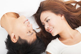 smiling Young couple  lying together