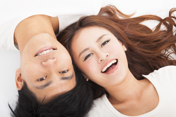 Young happy  couple  lying together