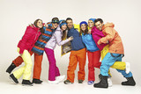 Group of cheerful snowboarders friends