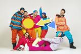 Colorful photo of the glad snowboarders