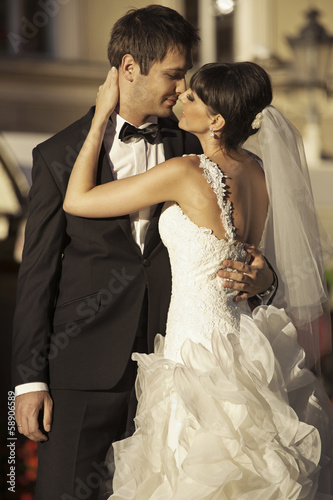 Lovely marriage couple kissing each other