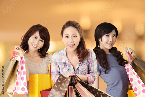 Happy smiling Asian shopping women