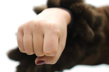 Aggressive fist of woman, a small DOF