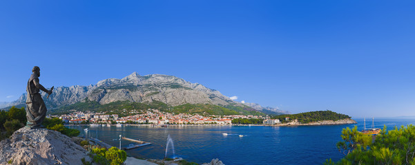 Panorama of Makarska and statue of St. Peter at Croatia